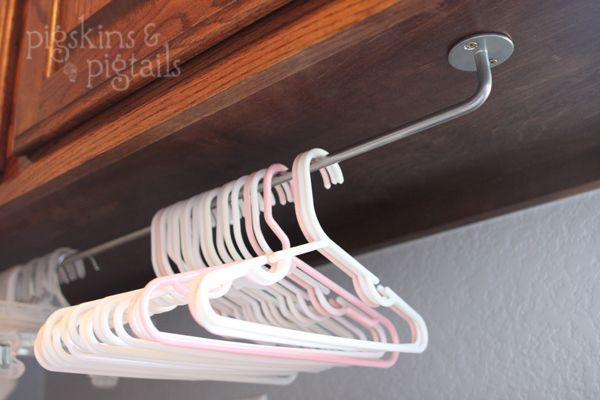 hanger organization under cabinets in laundry room - I like this, and have some IKEA rails on hand, too!