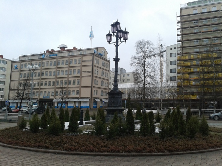 Some old-fashioned street light in front of some city hall in central Oulu.