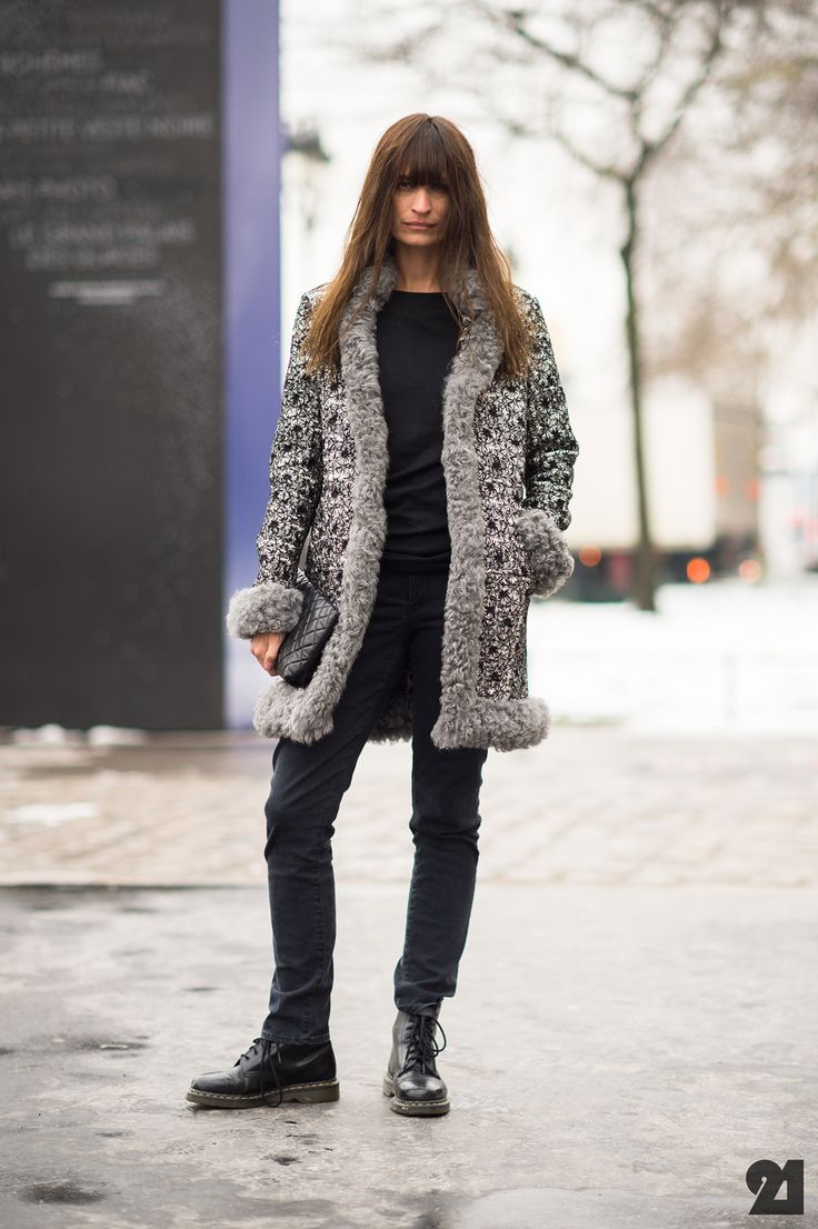 Caroline de Maigret in ACNE jeans, CHANEL shearling coat, DR MARTENS boots, and UNIQLO T-shirt.