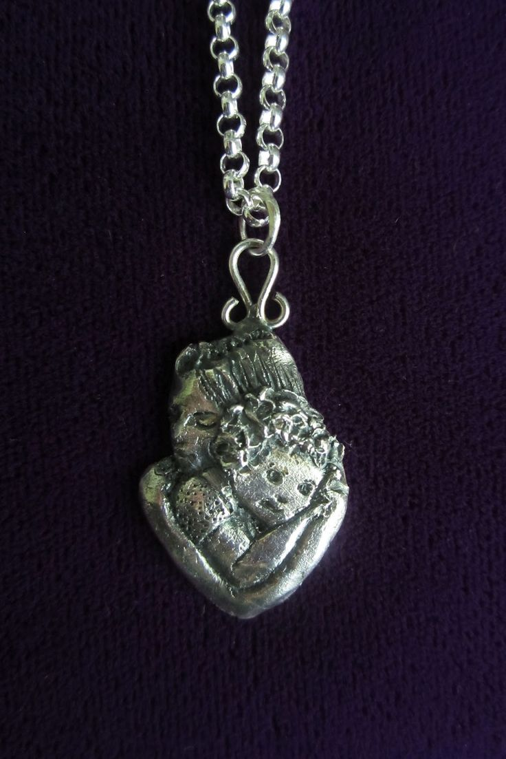 Mother and child - a silver pendant made of silver clay (Art Clay). Made by www.pinterest.com/miiairene/