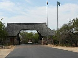 Skukuza;  Entrance to the camp    -gates are closed at night to keep larger animals out    Kruger National Park   South Africa
