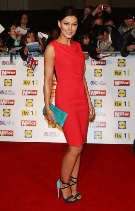 Emma Willis in a simple figure-hugging red dress with contrasting turquoise clutch at the Pride of Britain Awards