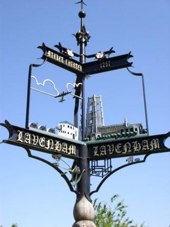 Lavenham, Suffolk - an elaborate three-way sign (see also the second picture). The decorative spaces below the name contain additional local motifs.