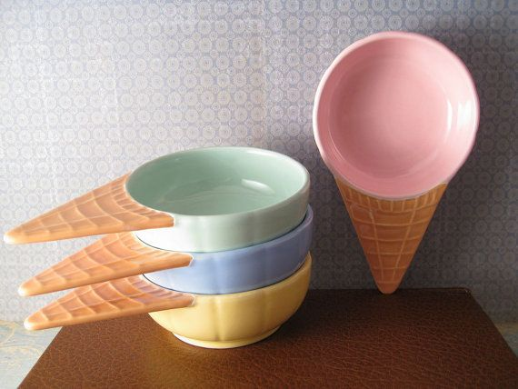 This listing is for a set of FOUR ice cream bowls, each a different color.    Each bowl measures approximately 6 1/2 x 1 1/2 x 4.    Excellent vintage condition