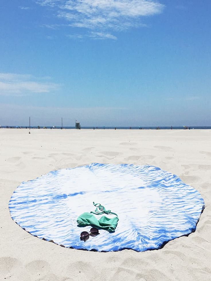 Hurry! Yes, you could totally make this next year or make it and take it on vacation, but let's celebrate the last few weeks of summer and really dig our heels into the sand and make the most of the long days, hot weather and beach trips! Tei is here to walk you through making your own shibori beach towel in under two hours for just about $10.