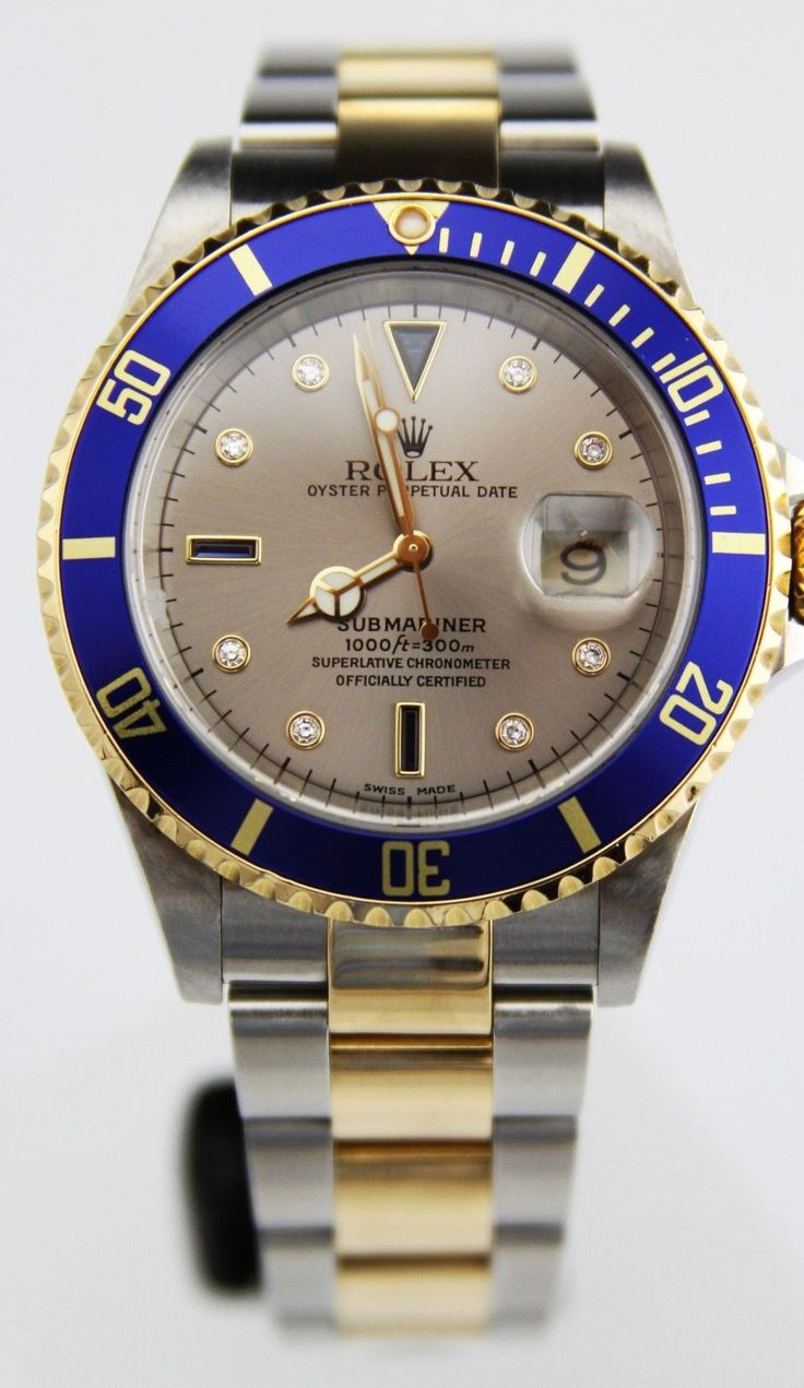 2002 18K Steel two tone #Rolex Submariner featuring blue bezel and silver serti dial with sapphire and diamonds. Original box included.