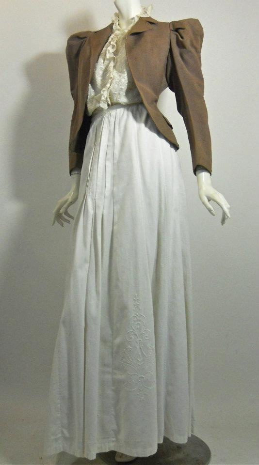 Victorian sporting set of fitted brown wool jacket with puff sleeves, nipped waist in back. Lace sleeveless bodice and heavy cotton skirt with embroidered detail on either side of front