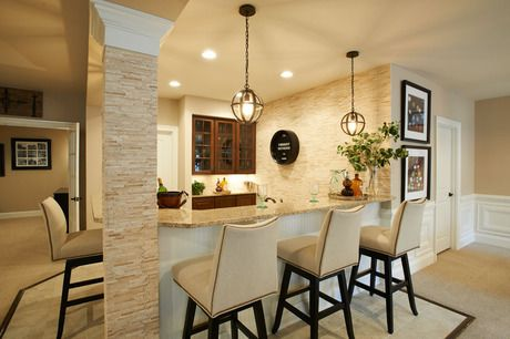 Glass Front Cabinets Stone Accents And Two Pendant Lamps