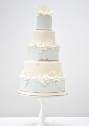 Magnolia  A chic modern wedding cake with masses of cream blossoms and a sugar magnolia