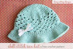 This adorable free sun hat is perfect for spring and summer. This particular hat fits girls ages 4-8. Make it using 100% cotton yarn so it's cool and breathable in the warmer months.