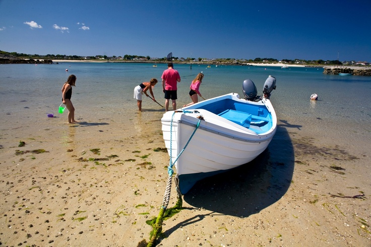 Enjoying traditional beach pastimes at Les Amarreurs, Guernsey.