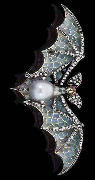 A cultured pearl, diamond, ruby and enamel bat brooch. Age uncertain, but in the Art Nouveau style. The body set with a pear-shaped pearl of grey tint, the outstretched wings decorated with pliqué-à- jour enamel, with single-cut diamond detail and ruby eyes, diamonds approx. 0.50ct. total, width 8.2cm.