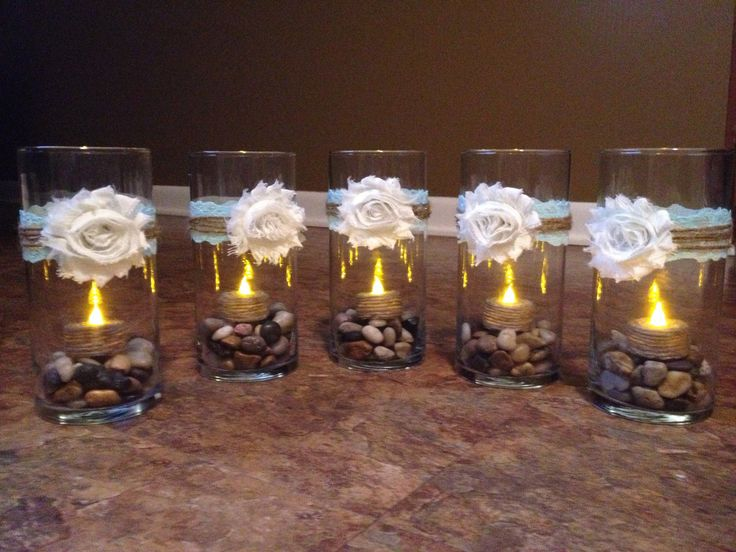 Vase centerpieces with rocks and LED tea
