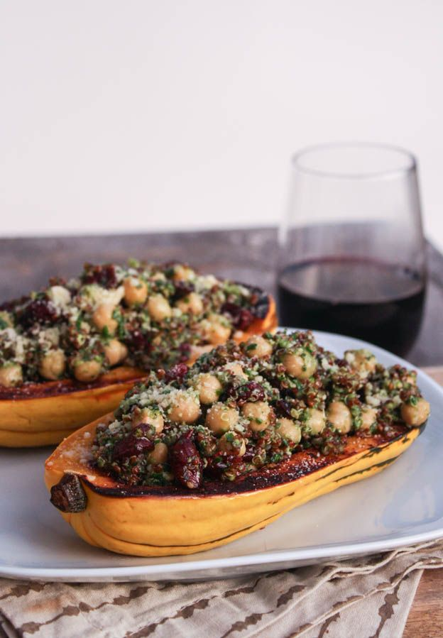 Stuffed Delicata Squash With Sage Pesto, Quinoa, and Cranberries -- beautiful vegetarian main dish. Like most pesto, this one calls for Parmesan cheese, but it's just as tasty without it!