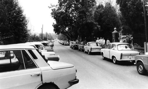"""East German Cars on Budapest Roadsides (Summer 1989)-As part of its political reforms, Hungary began dismantling its frontier barriers to Austria on May 2, 1989. This afforded East German citizens an unexpected escape route; the """"Iron Curtain"""" had suffered its first tear. This picture shows numerous East German """"Trabants"""" and """"Wartburgs"""" parked on a Budapest street. East German refugees had driven to Hungary in these cars but abandoned them when they fled to the West."""
