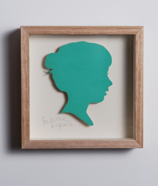 Coco. 3mm plywood silhouette, painted in Bittersweet. Cream mount, name/age written in pencil. Oak frame. 210mm wide x 230mm high x 50mm deep.