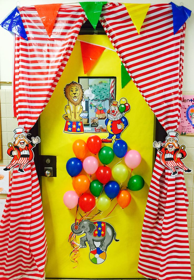 Circus theme classroom door. School spirit. Curtain. Balloons. Pennant banner. Carnival. Teacher appreciation day. Cute Class door. Stripes. Elephant. Lion. Welcome. Big top. school door idea.