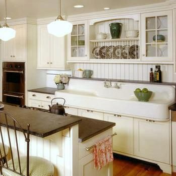 Farmhouse kitchen....that sink!! love Island, lighting, beadboard, cupboards too