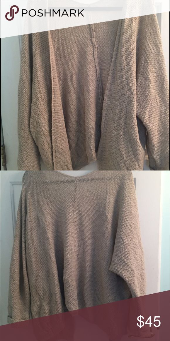 Brandy Melville Cardigan Great condition tan Brandy Melville Cardigan! One size fits all and a beautiful sand color that goes with everything! Has no tags but is Brandy! Brandy Melville Sweaters Cardigans