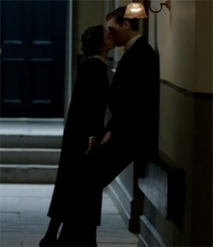 Martha's maid steals a kiss from Alfred on Downton Abbey Season 3 Episode 2