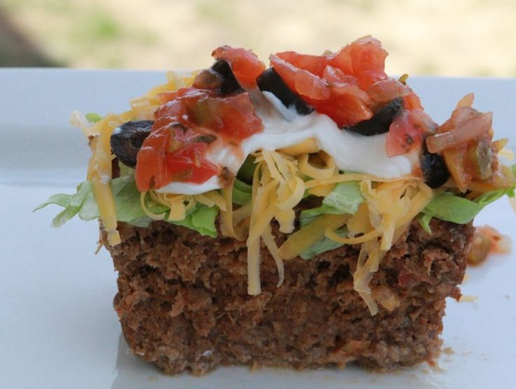 Mexican Meatloaf....make this in a large muffin tin and make mini loaves....cut cooking time in half!  Serve with a green salad topped with ranch and a sprinkle of chili powder!