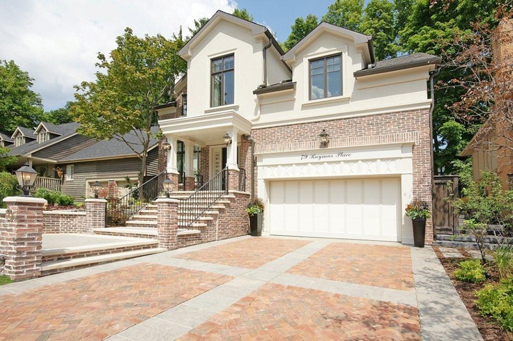 Everything from the brick to stucco and surrounding area design works in perfect harmony.