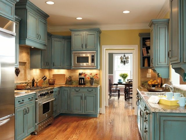 Turquoise rustic cabinets. Such a beautiful kitchen.