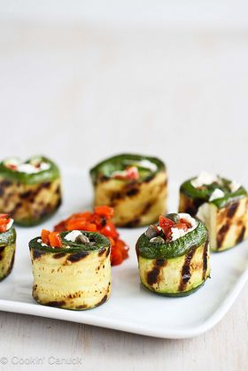 Soft goat cheese, roasted peppers and capers are rolled inside of grilled and tender zucchini. What a beautiful appetizer!