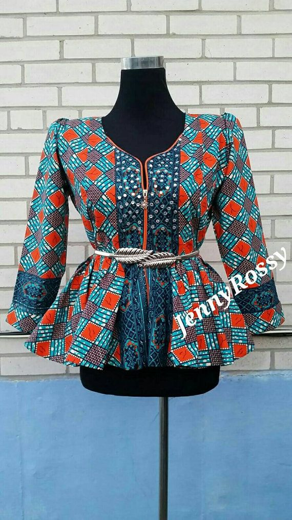 Hey, I found this really awesome Etsy listing at https://www.etsy.com/pt/listing/262963991/jenny-rossy-african-print-peplum-top