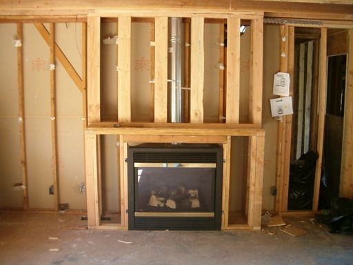 How to frame in a gas fireplace framing for fireplace for Corner fireplace framing plans