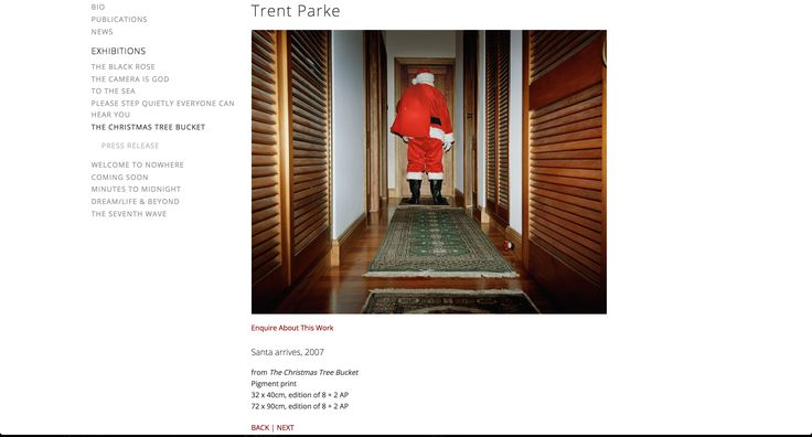 'Santa Arrives' from the series 'The Christmas Tree Bucket' is a photo by Trent Parke. The unatural lighting that bounces through the hallway creates an unsettling feeling as the subject who is depicted as Santa faces away from the camera. The stance that he has towards the closed door creates an activley dangerous and eerie mood