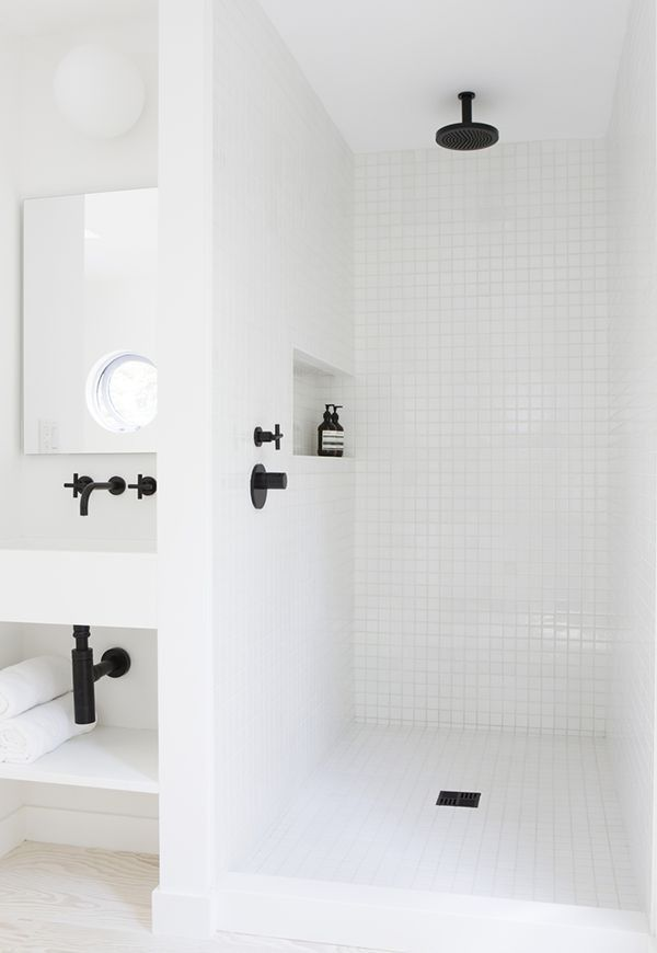 Amee Allsop Bath with Black Tapware | Remodelista. SO similar to my Edgemere shower, but with the black hardware adding a nice visual pop.