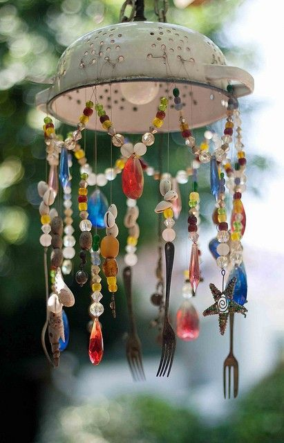 A garden wind chime made from a kitchen colander, some silverware, beads and shells.    via 1Beauty