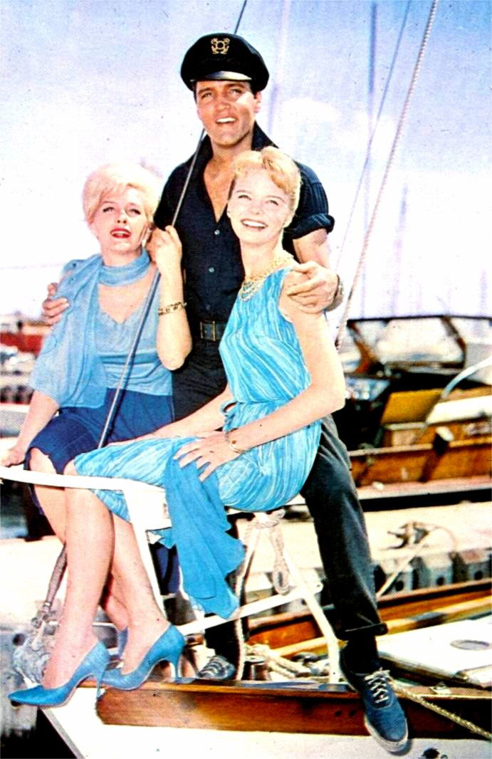 Elvis with his co-stars Laurel Goodwin and Stella Stevens on the King fisher boat between takes ...