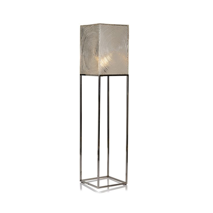 Contemporary floor lamp with faux wood grain shade by Oly. Cast resin shade with stainless steel base. Coco $1635