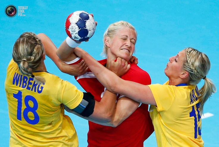 Denmark's Rikke Skov is challenged by Sweden's Johanna Wiberg and Johanna Ahlm during their women's handball Preliminaries Group B match at the Copper Box venue of the London 2012 Olympic Games. MARKO DJURICA/REUTERS