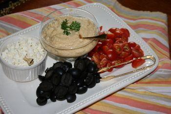 Hummus platter: Hummus, feta, kalamata olives, tomatoes and syrian bread. Spread hummus choose toppings great appetizer