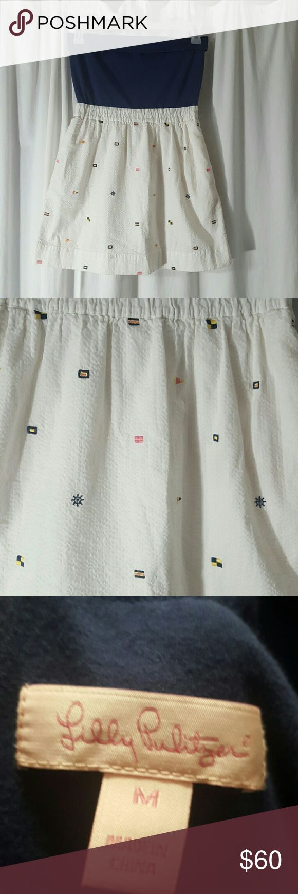 Lilly Pulitzer nautical flag dress. EUC- Adorable, authentic dress by Lilly Pulitzer. Bottom is seersucker and covered in cute little embroidered nautical flags. What could be better? Pockets! A must have for boaters and water lovers. Size M. Dresses Strapless