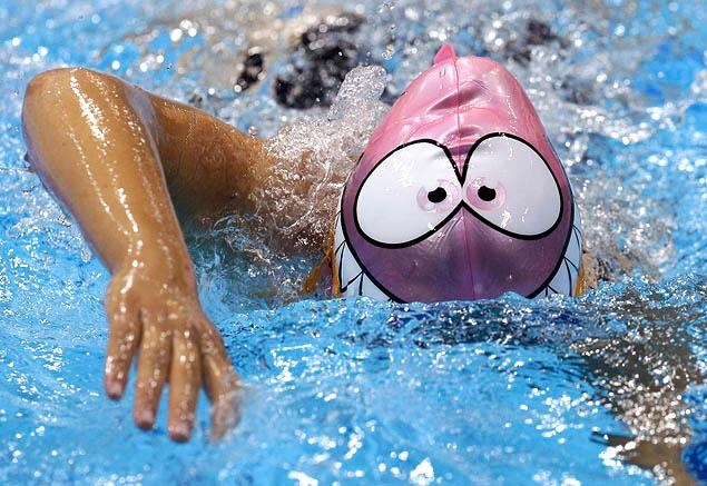 Creative Tonic loves swimming!   Everybody out of the pool! Jennet Saryyeva of Turkmenistan has some fun by wearing a not-so-menacing swim cap during a training session in Olympic Park.