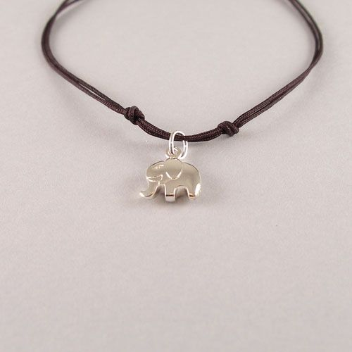 Cute Bracelet with a .925 silver Elephant charm. The Thread is hand knotted into a sliding knot. The ends of the threads are knotted with .925 silver beads.