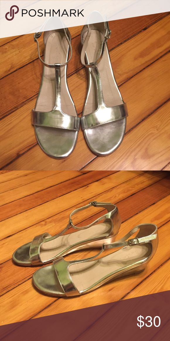 Boden Silver Metallic Wedge Sandals Boden Silver Metallic Wedge Sandals.  Size 39 (9M) Only worn twice.  The neutral silver color makes them perfect to go with everything this spring. Boden Shoes Sandals