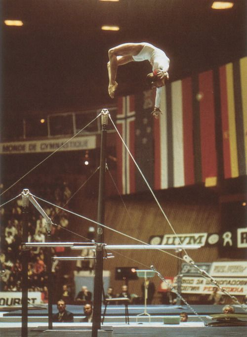 """Olga Korbut performing the spectacular and since banned """"Korbut Flip"""" at the 1974 World Gymnastics Championships held at Varna, Bulgaria. At this meet, Korbut medalled in every women's event, walking away with 2 Golds (Team, Vault) and 4 Silvers (All Around, Beam, Uneven Bars, Floor)."""