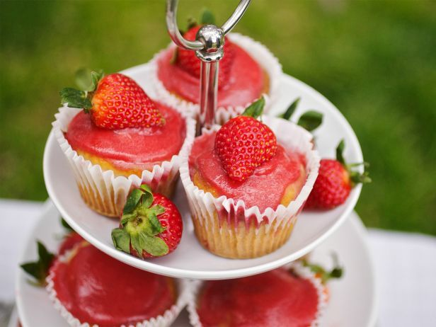 Sweet Thing : Kids and adults alike will love this sweet recipe for Trisha's Strawberry Cupcakes. Top each one with a slice of fresh strawberry with the stem still attached, then pile the whole batch high on a multitiered cake stand for a bright and tasty focal point.