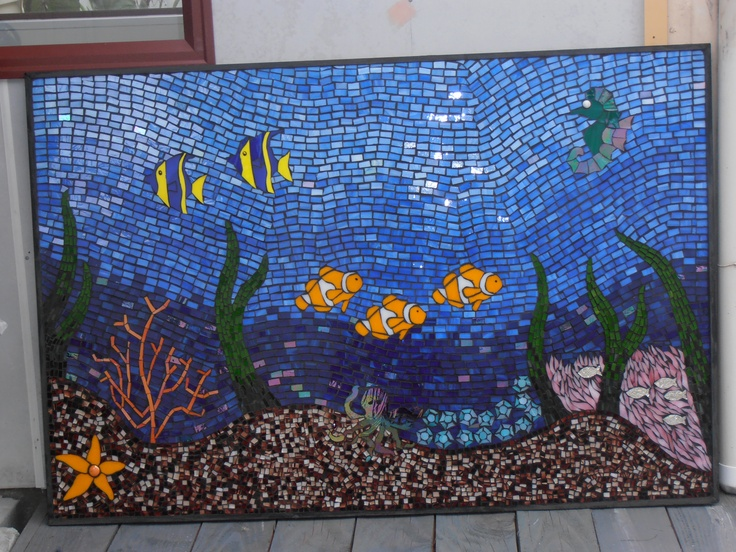 Reef Mosaic 1.2m wide and 1m high all in stained glass hand cut and placed, grouted in charcoal framed in black on plywood.