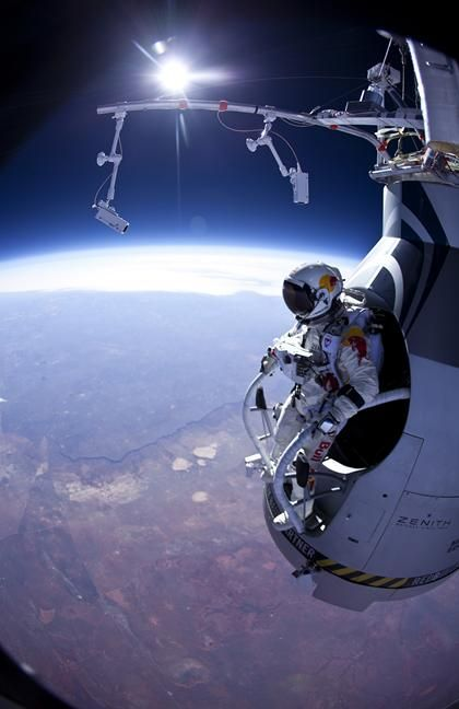 Baumgartner, who hopes to jump from 23 miles later this year, was carried aloft by a capsule-equipped helium balloon. Wearing a pressurized space suit, he jumped at roughly 71,581 (13.6 miles), reaching 364 mph during the 3-minute, 43-second free fall before opening his chute, according to his Red Bull Stratos project. The entire jump lasted 8 minutes, 8 seconds.