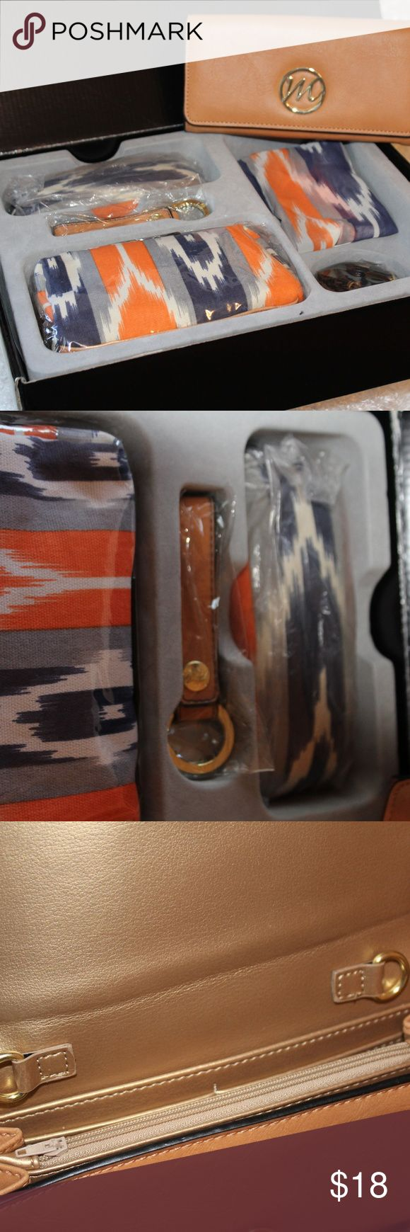 Sahara Breeze Gift Set Brand new in box! This is a fantastic little gift set!  matching wallet, cosmetic case, eyeglass case, key chain, and scarf. Also included is a strap for the wallet. Sahara Breeze Accessories