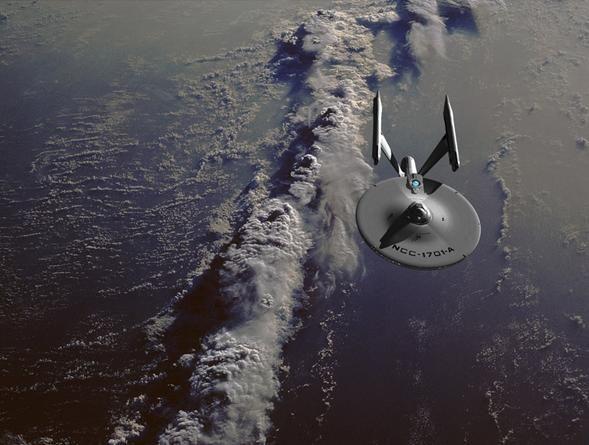 #STARFLEET INTELLIGENCE: starship Enterprise-A over Earth clouds .