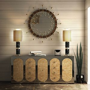 A contemporary descendant of mid-century modern style, Quantum circular wall mirror is not just a spot-on reflection of the atomic age design, it is a leap forward. A set of gold plated spheres arranged in a circular pattern create a stunning visual effect. It is the ideal finishing touch for a modern living room or bedroom. A magnificent design inspired in the 50's legacy.