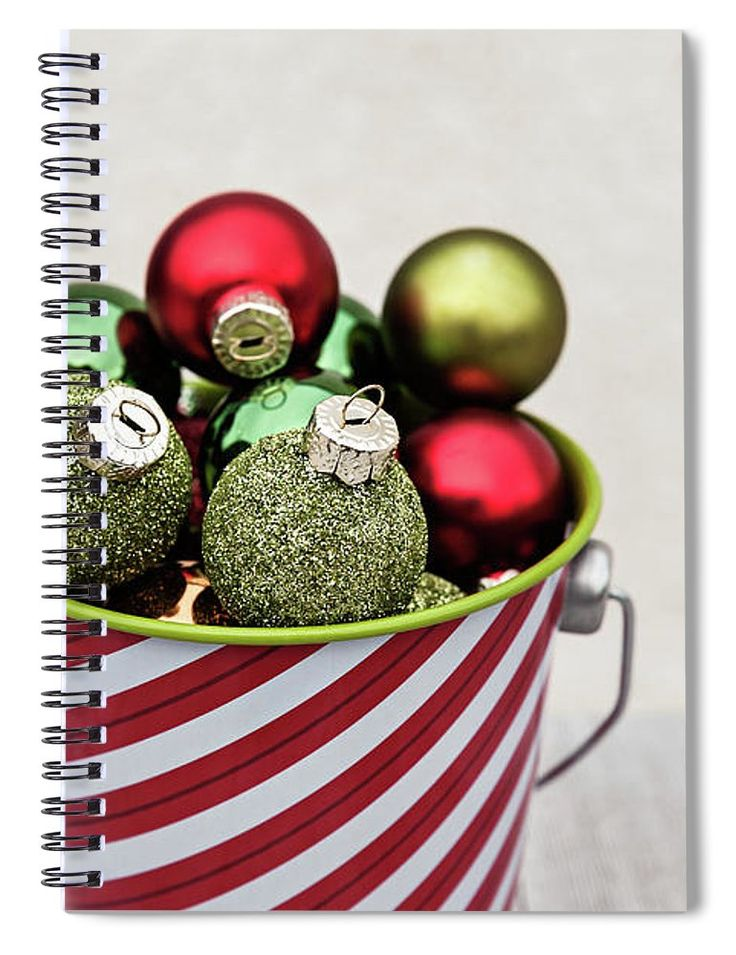 "Spiral Notebook featuring the photograph Striped Bucket With Ornaments by Evgeniya Lystsova. Closeup of Festive Small Balls Collected in Striped Bucket for Christmas, Winter Holiday Concept. Our spiral notebooks are 6"" x 8"" in size and include 120 pages which are lined on both sides. The Artwork is printed on the front cover. #SpiralNoteBook #Gifts #Christmas #Prints #OfficeDecor"