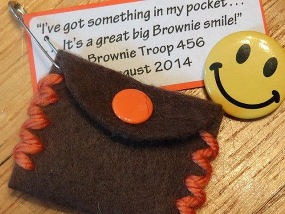 """Brownie Smile craft/SWAP - They are perfect for a bridging ceremony, sing-a-long, troop meeting, or campout. """"I've got something in my pocket It belongs across my face! I keep it very close at hand, in a most convenient place. I'm sure you wouldn't guess it if you guessed a long, long while. So, I'll take it out and put it on. It's a great big Brownie smile!"""" Now, your girls can make SWAPs that remind them of the special memories this song evokes."""